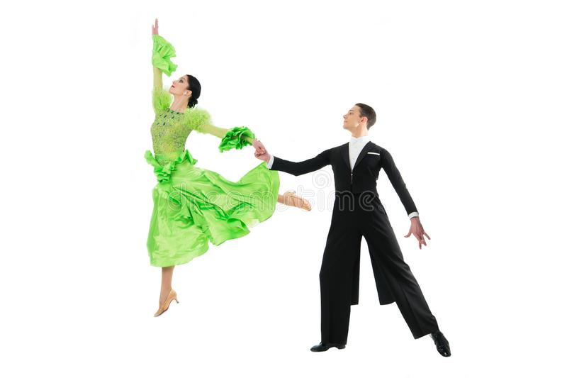 Ballroom dance couple in a dance pose isolated on white background. ballroom sensual proffessional dancers dancing walz. Ballroom dancing. ballroom dance couple stock photo