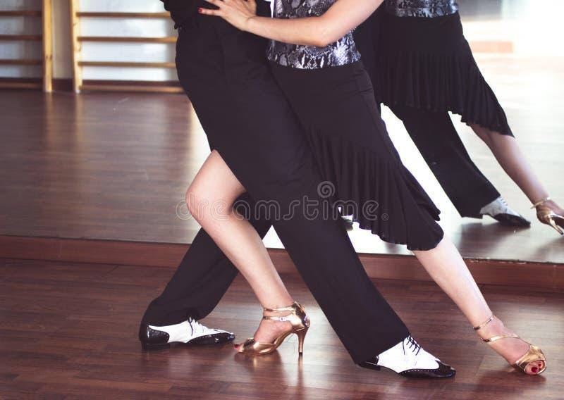 Ballroom dance dancers. Ballroom dance couple of dancers and teachers in studio school dancing in rehearsal royalty free stock photos