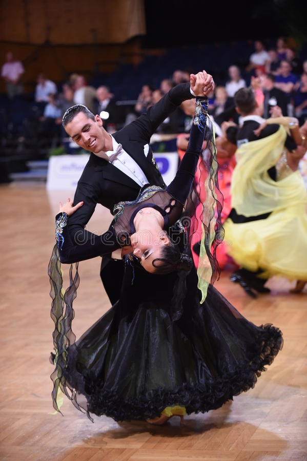 Ballroom dance couple, dancing at the competition. Stuttgart, Germany - August 16,2014: An unidentified dance couple in a dance pose during Grand Slam Standart stock photos