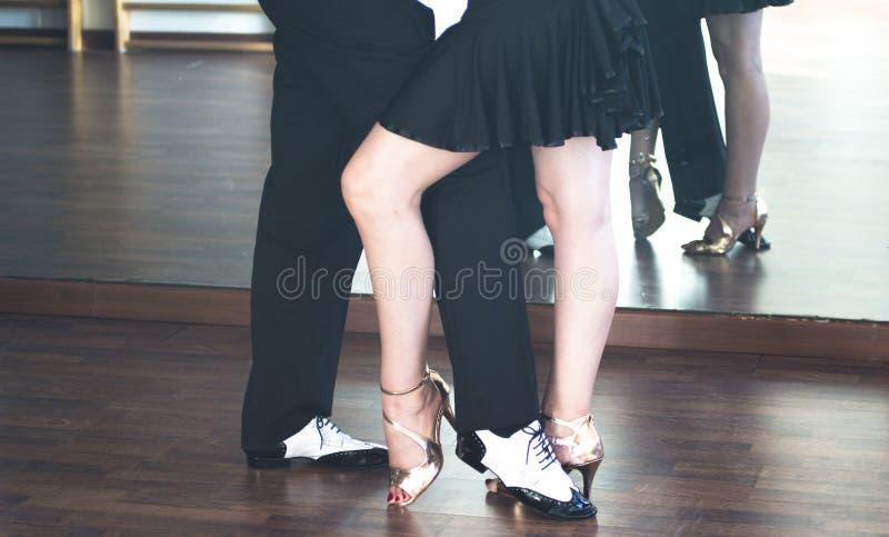 Ballroom dance dancers. Ballroom dance couple of dancers and teachers in studio school dancing in rehearsal stock photos