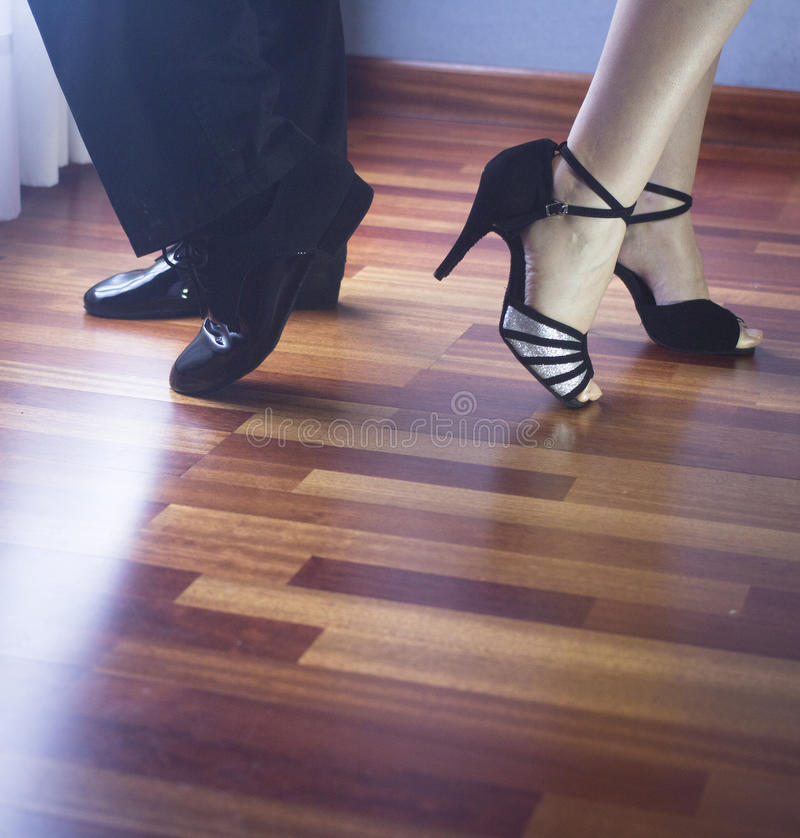 Ballroom dance latin dancers. Male and female ballroom, standard, sport dance, latin and salsa couple dancers feet and shoes in dance academy school rehearsal stock images