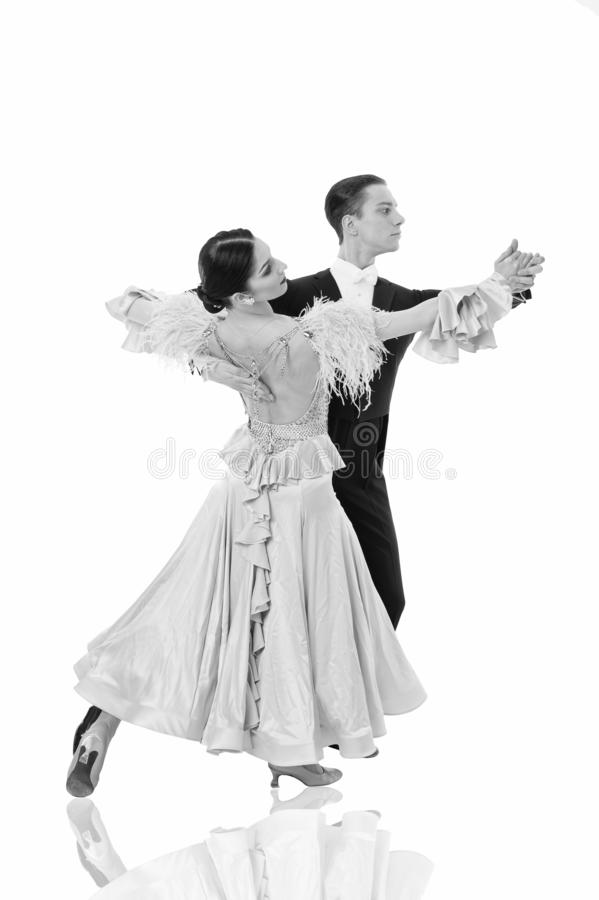 Ballroom dance couple in a dance pose isolated on white background. ballroom sensual proffessional dancers dancing walz. Ballroom dance pose. ballroom dance stock images