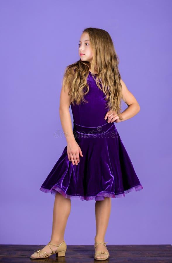 Ballroom dancewear fashion concept. Kid dancer satisfied with concert outfit. Ballroom fashion. Girl child wear velvet. Violet dress. Clothes for ballroom dance stock images