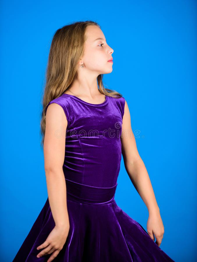 Ballroom dancewear fashion concept. Kid dancer satisfied with concert outfit. Clothes for ballroom dance. Ballroom. Fashion. Girl child wear velvet violet dress royalty free stock photography