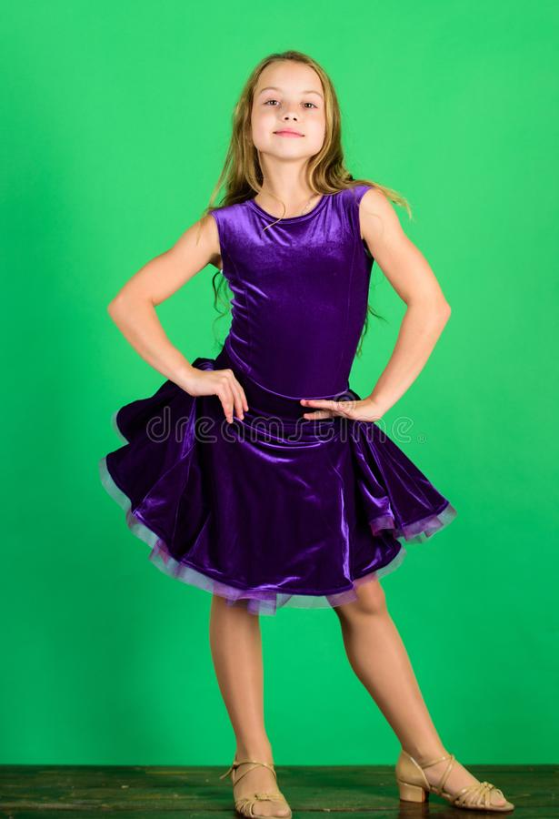 Ballroom dancewear fashion concept. Kid dancer satisfied with concert outfit. Kids fashion. Kid fashionable dress looks. Adorable. Girl cute child wear velvet stock photos