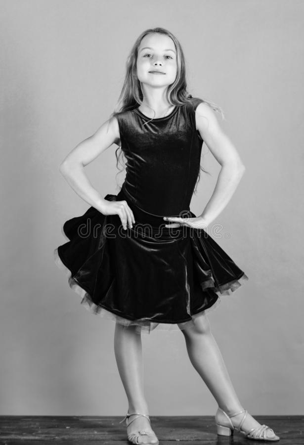 Ballroom dancewear fashion concept. Kid dancer satisfied with concert outfit. Kids fashion. Kid fashionable dress looks. Adorable. Girl cute child wear velvet stock photography