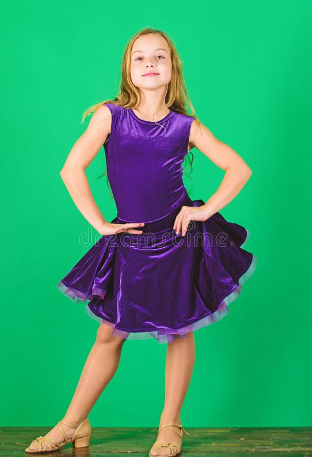 Ballroom dancewear fashion concept. Kid dancer satisfied with concert outfit. Kids fashion. Kid fashionable dress looks. Adorable. Girl cute child wear velvet stock photo