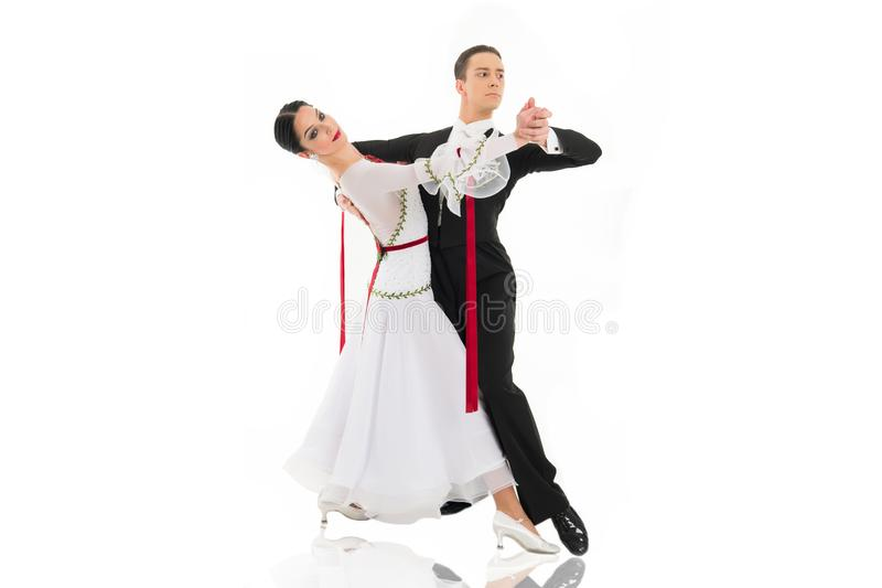 Ballroom dance couple in a dance pose  on white background. ballroom sensual proffessional dancers dancing walz. Ballroom dancing. ballroom dance couple in a royalty free stock photo