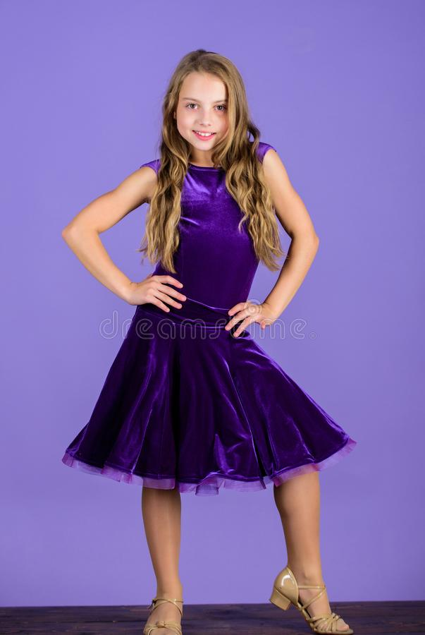 Ballroom fashion. Girl child wear velvet violet dress. Clothes for ballroom dance. Kid fashionable dress looks adorable. Ballroom dancewear fashion concept royalty free stock photos