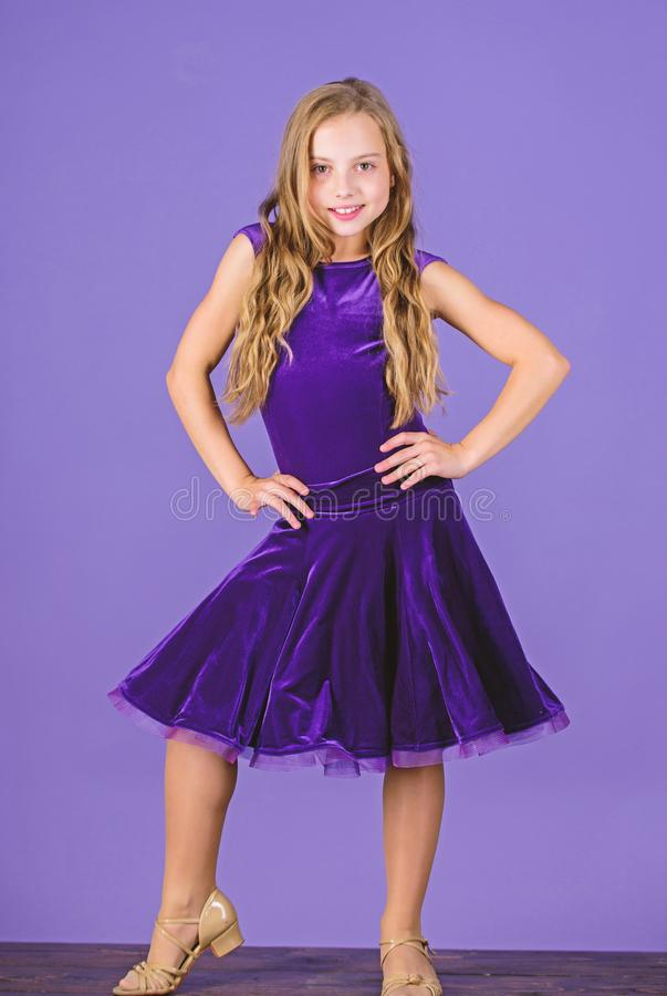 Ballroom fashion. Girl child wear velvet violet dress. Clothes for ballroom dance. Kid fashionable dress looks adorable. Ballroom dancewear fashion concept stock photos