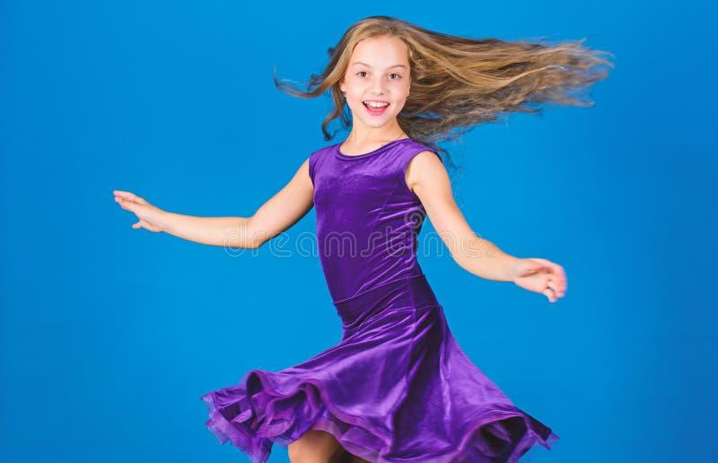 Ballroom fashion. Girl child wear velvet violet dress. Kid fashionable dress looks adorable. Ballroom dancewear fashion. Concept. Kid dancer satisfied with stock images