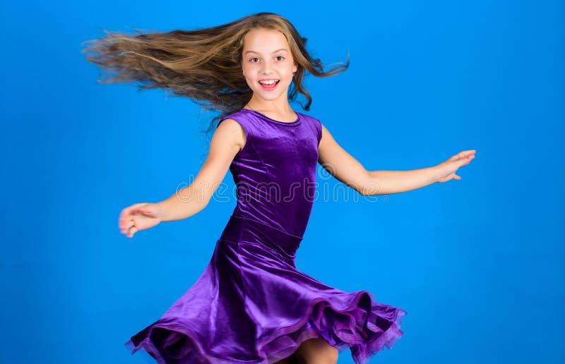 Ballroom fashion. Girl child wear velvet violet dress. Kid fashionable dress looks adorable. Ballroom dancewear fashion. Concept. Kid dancer satisfied with stock photography