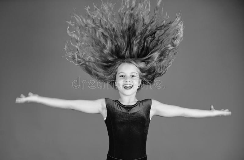 Ballroom latin dance hairstyles. Kid girl with long hair wear dress on blue background. Hairstyle for dancer. How to. Make tidy hairstyle for kid. Things you stock photos