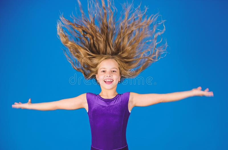 Ballroom latin dance hairstyles. Kid girl with long hair wear dress on blue background. Hairstyle for dancer. How to. Make tidy hairstyle for kid. Things you stock images