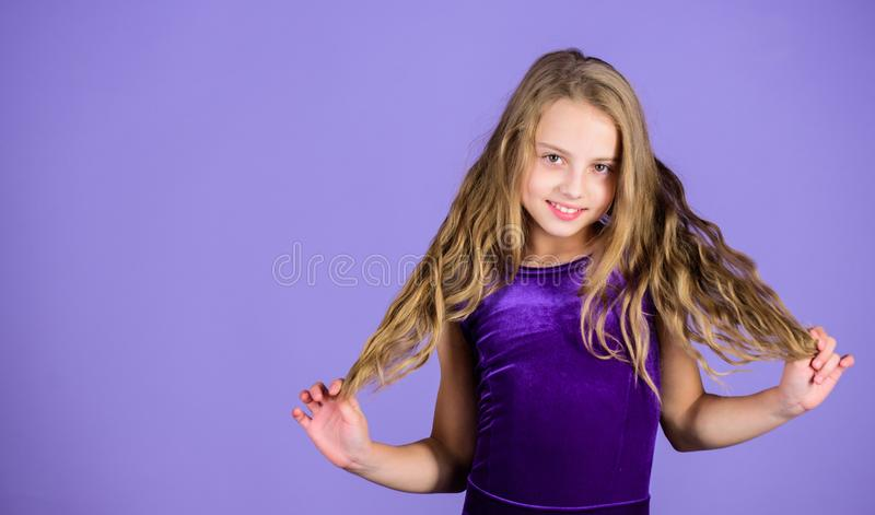Ballroom latin dance hairstyles. Kid girl with long hair wear dress on violet background. Hairstyle for dancer. How to. Make tidy hairstyle for kid. Things you stock photos