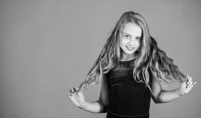 Ballroom latin dance hairstyles. Kid girl with long hair wear dress on violet background. Hairstyle for dancer. How to. Make tidy hairstyle for kid. Things you stock photography