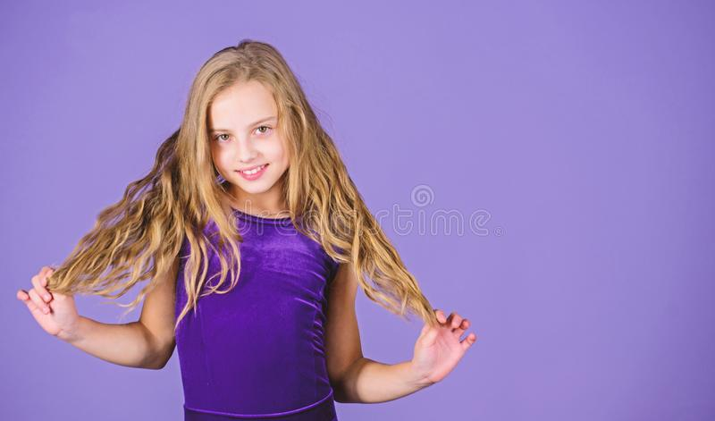 Ballroom latin dance hairstyles. Kid girl with long hair wear dress on violet background. Hairstyle for dancer. How to. Make tidy hairstyle for kid. Things you stock image