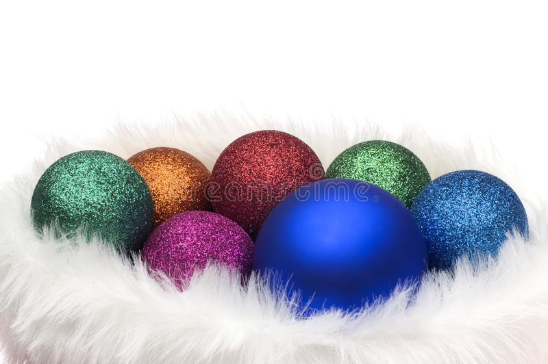 Balls. Colorful christmas balls in hat close up on white royalty free stock photos