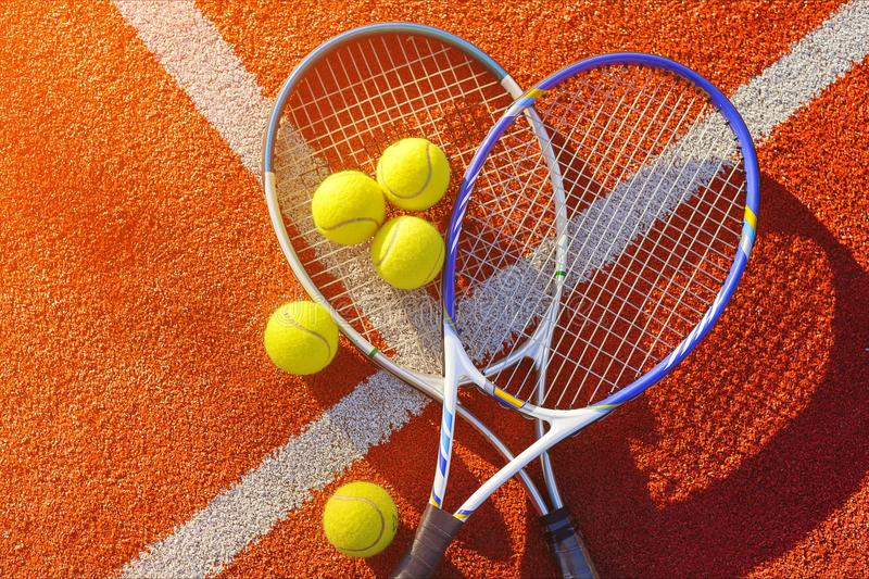Tennis game. Tennis balls and rackets on royalty free stock images