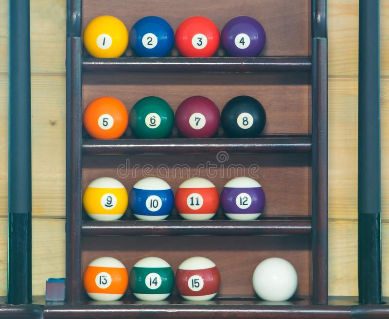 Balls for billiards, stand in a row in order on the rack for storing a set of inventory for playing pool royalty free stock images