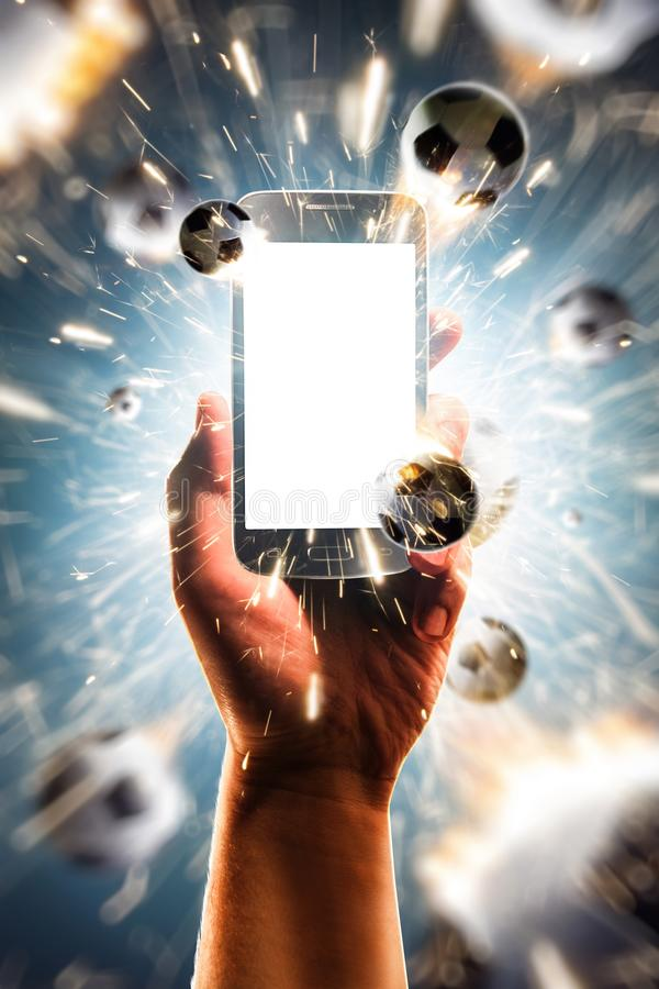 Balls are flying from a smartphone with a white screen royalty free stock photo