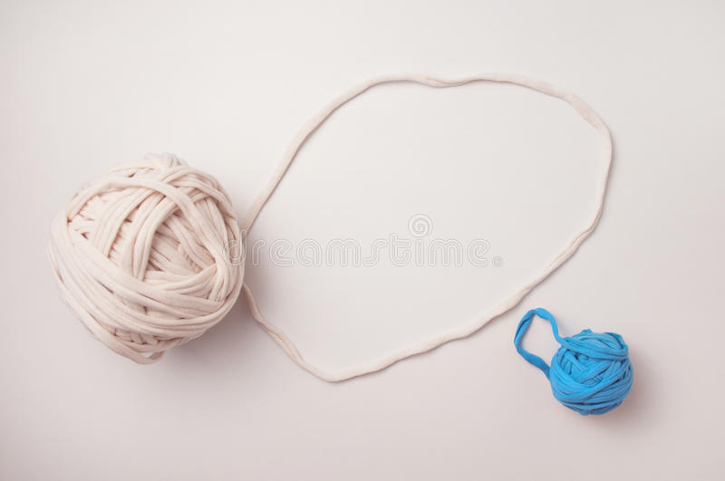 Balls of T shirt yarn on the table stock photography