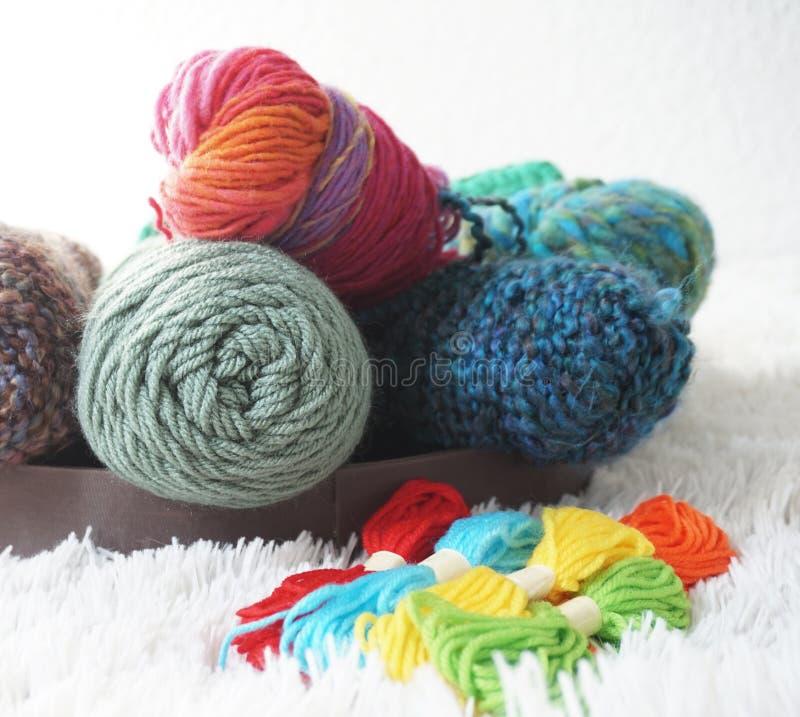 Balls of wool in cozy carpet -Detail stock photo