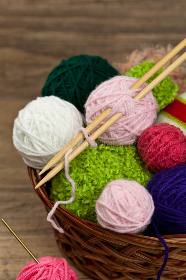 Balls of yarn. Colorful yarn balls in wicker basket. Selective focus stock photography