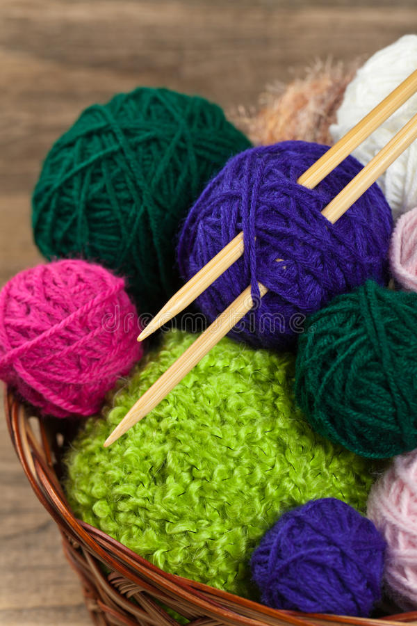 Balls of yarn. Colorful yarn balls in wicker basket. Selective focus royalty free stock image