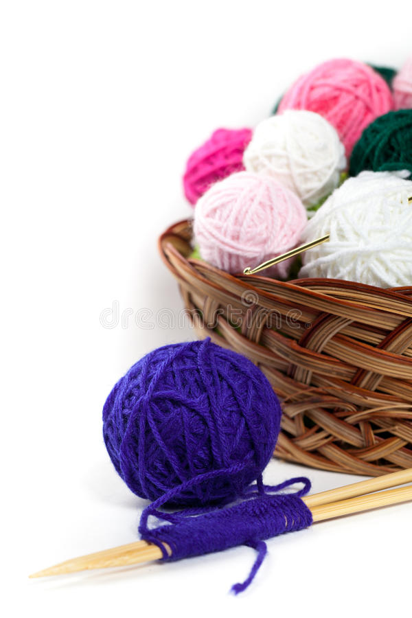 Balls of yarn. Colorful yarn balls in wicker basket. Selective focus royalty free stock photography