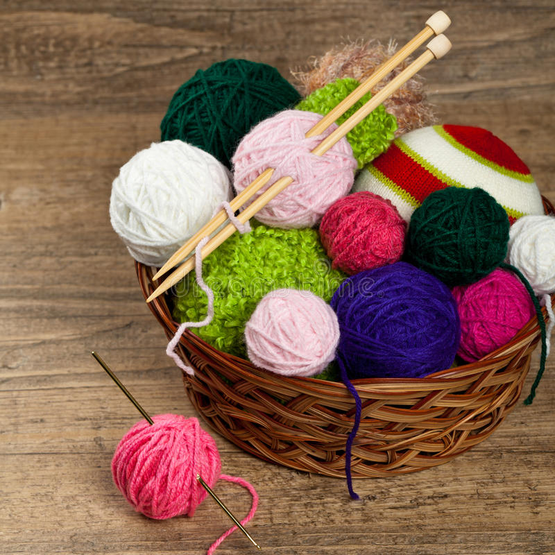 Balls of yarn. Colorful yarn balls in wicker basket. Selective focus royalty free stock photos