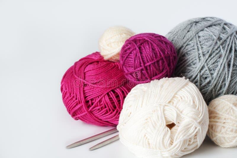 Balls of yarn for knitting. Several bright balls of yarns for creative knitting stock photos