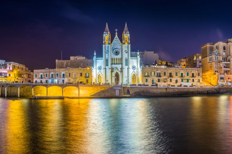 Balluta bay, Malta - Panoramic view of the famous Church of Our Lady of Mount Carmel at Balluta bay by night royalty free stock images