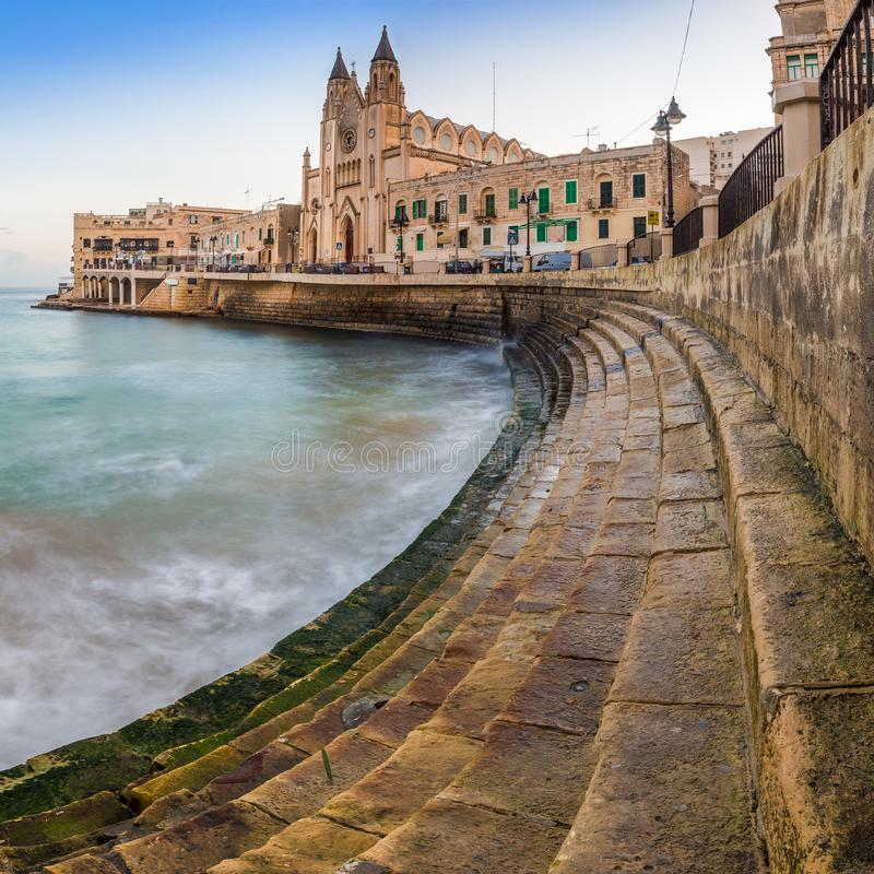 Balluta Bay, Malta - The steps of Balluta bay with the Church of our Lady Mount Carmel stock photos