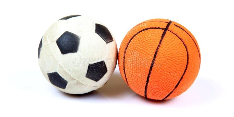 Baloncesto y balompié imagen de archivo libre de regalías