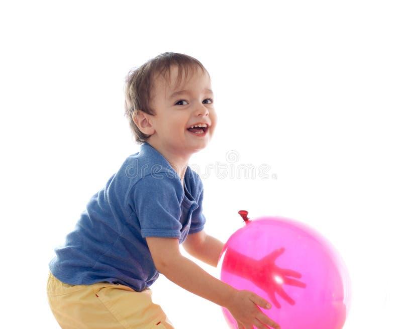 balonowej chłopiec śliczny mały różowy bawić się obraz royalty free