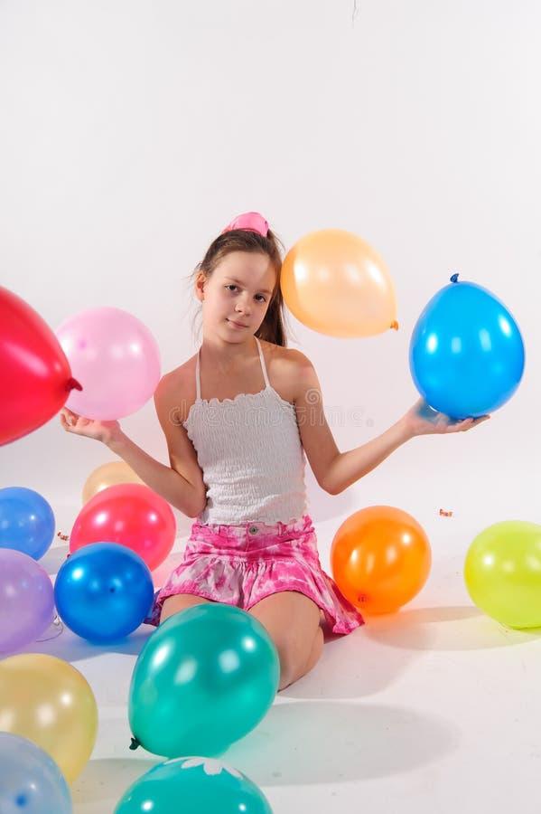 baloons逗人喜爱的滑稽的女孩一点 库存照片