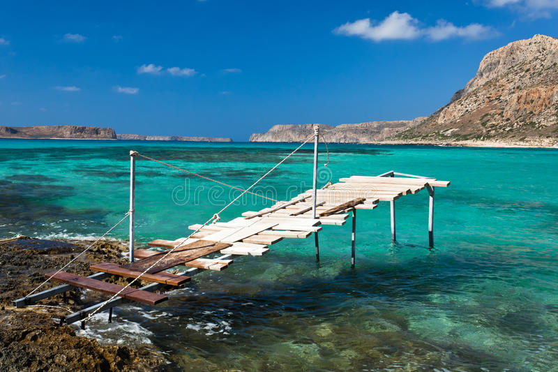 Balos bay (Crete, Greece). Wooden pier for sightseeing boats in Balos bay, Crete, Greece royalty free stock image