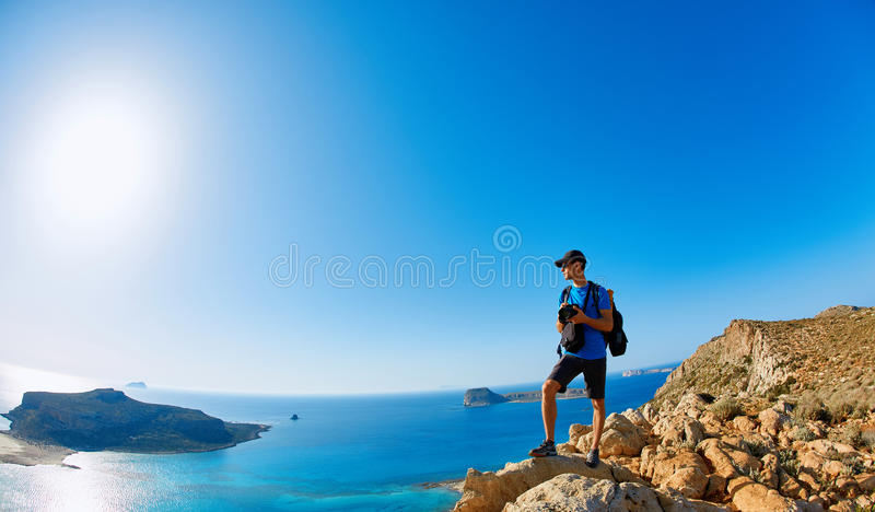 Balos beach, Crete. Panoramic view on Balos beach, Crete, Greece. Man, traveller and photographer stands on the cliff stock image