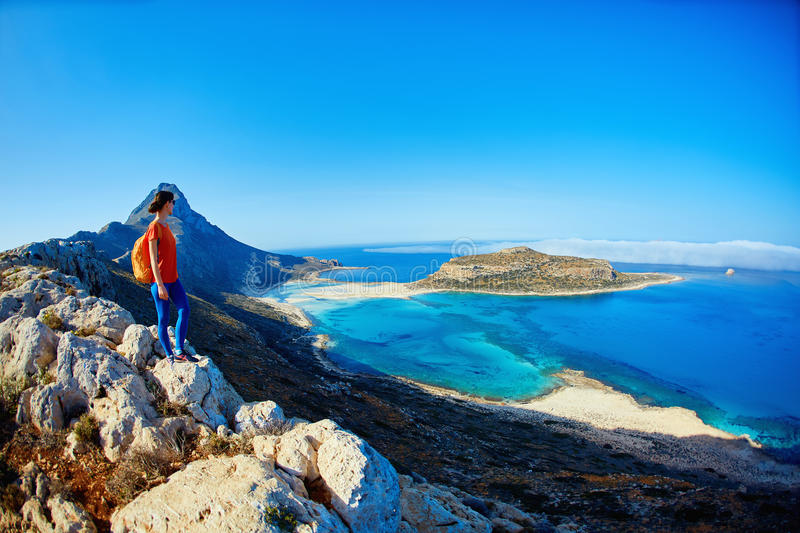 Balos beach, Crete. Panoramic view on Balos beach, Crete, Greece. Woman, traveller stands on the cliff against sea background stock photos