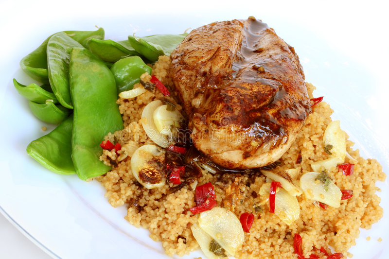 Balsamic Chicken and Garlic Cous Cous stock images