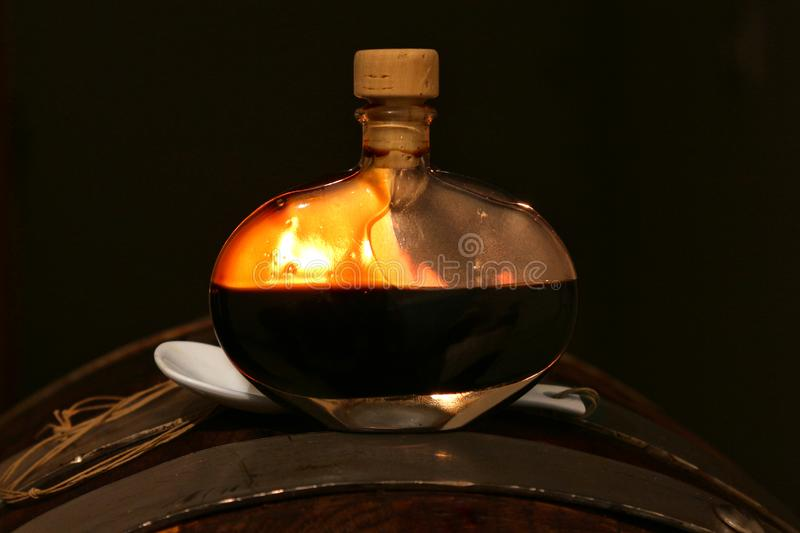 Balsamic vinegar of Modena, Italy, glass bottle containing special sweetening Modena stock photography