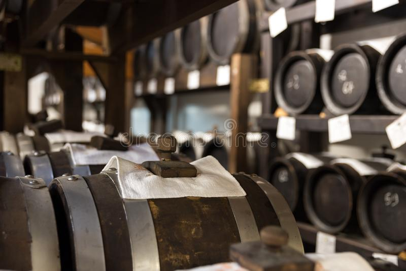 Balsamic vinegar wooden barrels storing and aging royalty free stock image