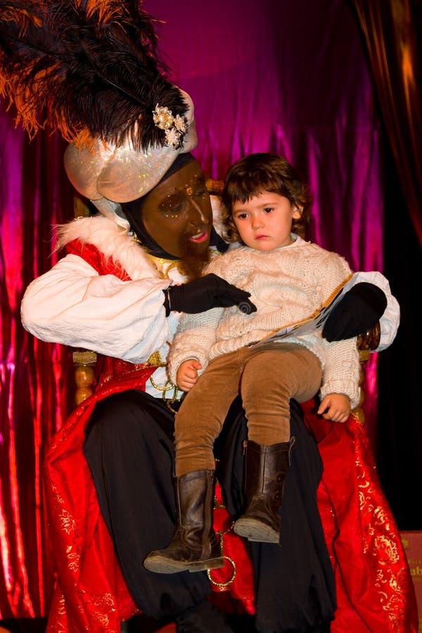 Balthazar King e bambina immagini stock libere da diritti