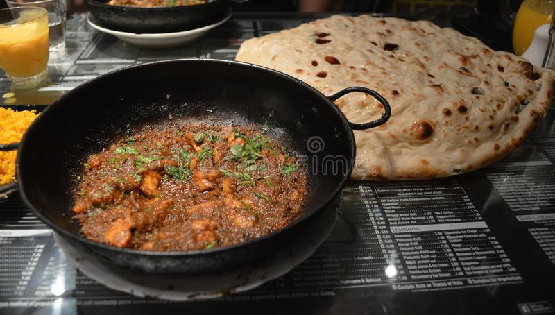 Birmingham balti curry meal with giant naan bread. The Balti curry and giant naan bread a local must eat when in the balti Triangle; an area of balti houses royalty free stock photos