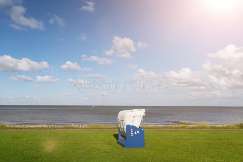 Baltic beach chair at north sea coast stock images