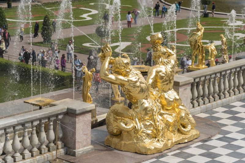 Golden statues of the Grand Cascade in Peterhof Palace St Petersburg Russia. Majestic ensemble of fountains with unique, opulent architecture. Peterhof Palace stock photos