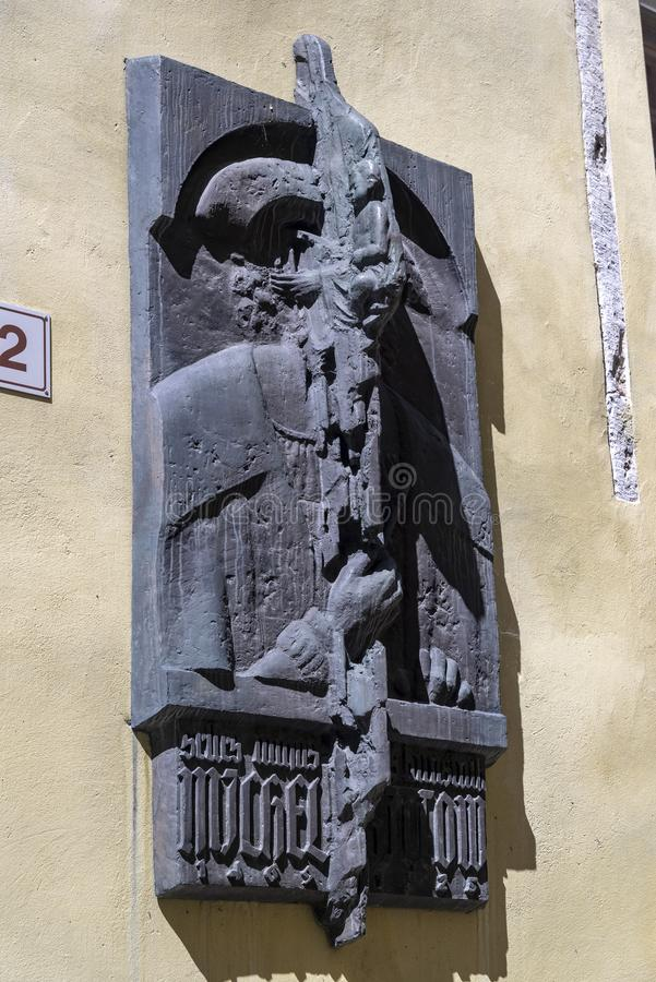 Wall sculpture Tallinn. Tallinn, Estonia's capital on the Baltic Sea, is the country's cultural hub. It retains its walled, cobblestoned Old Town royalty free stock photos