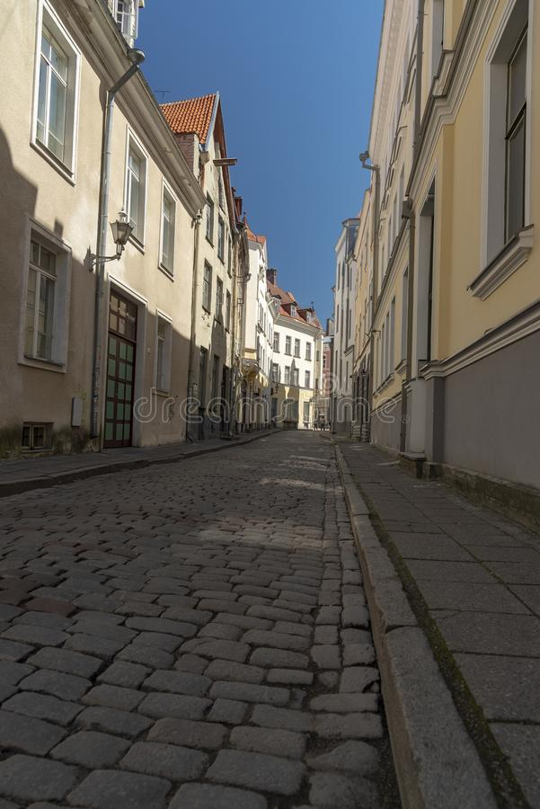 Cobbled street in Tallinn. Tallinn, Estonia's capital on the Baltic Sea, is the country's cultural hub. It retains its walled, cobblestoned Old royalty free stock image