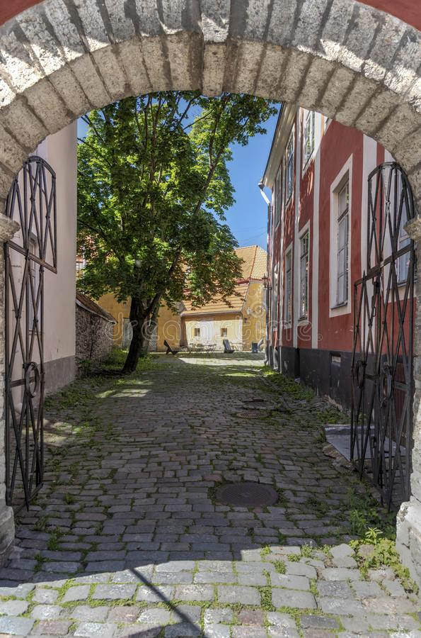 Cobbled courtyard in Tallinn. Tallinn, Estonia's capital on the Baltic Sea, is the country's cultural hub. It retains its walled, cobblestoned stock photo